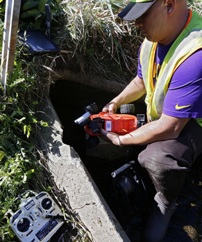 Inspector deploys HIVE in culvert.