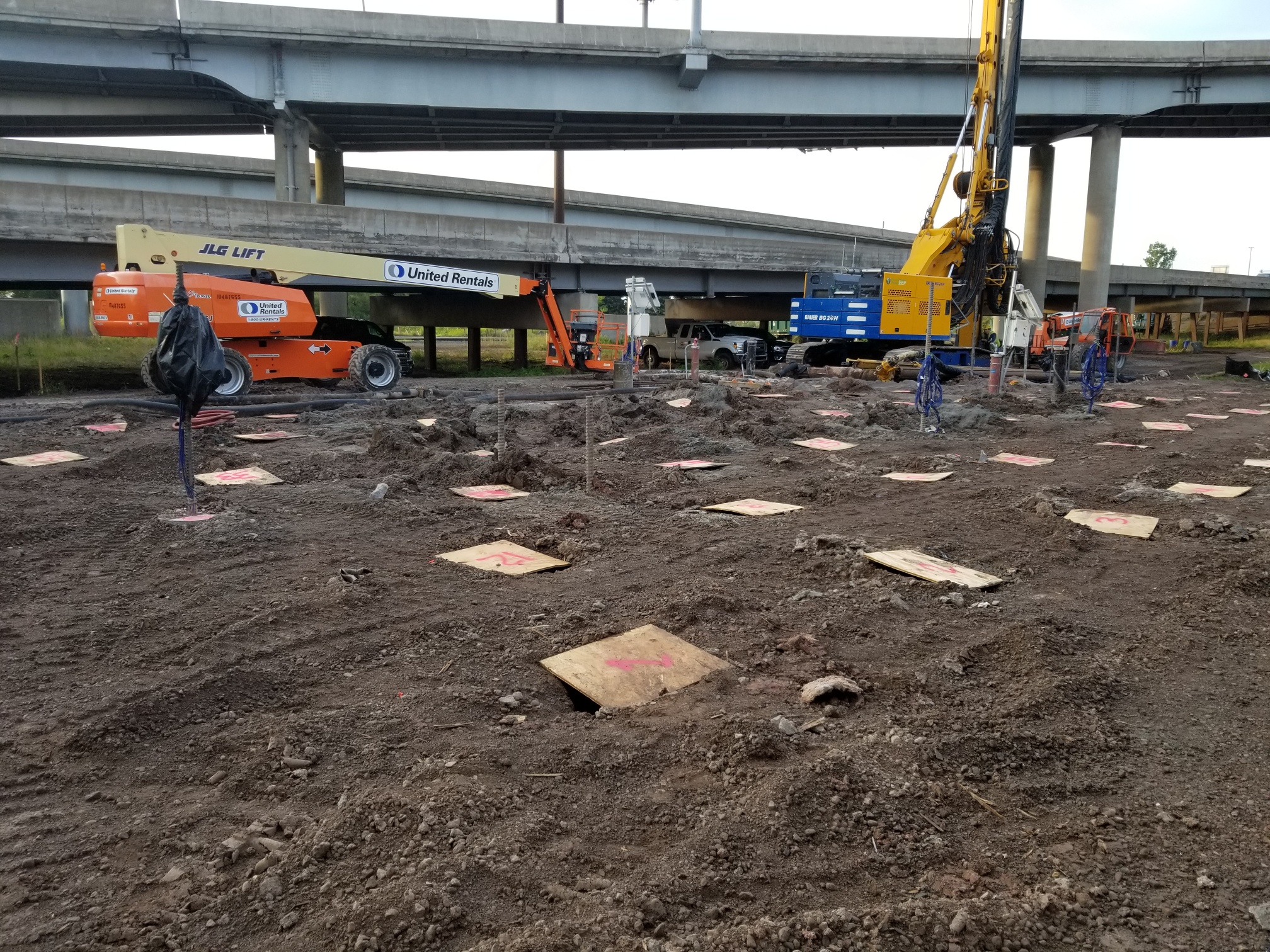 Placing ground improvements, which is basically a grid pattern of 16 grout columns inserted into the ground to a hard layer. This will support the eventual roadway fill.