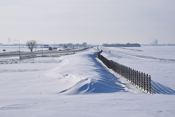 Structural snow fence with drift located on Interstate 94 and Highway 336.