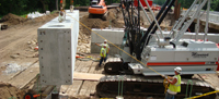 Precast portions being put in place
