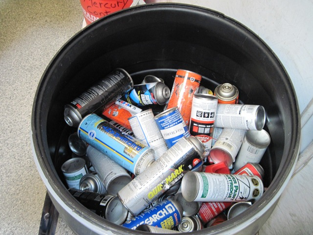 Barrel of hazardous spray cans