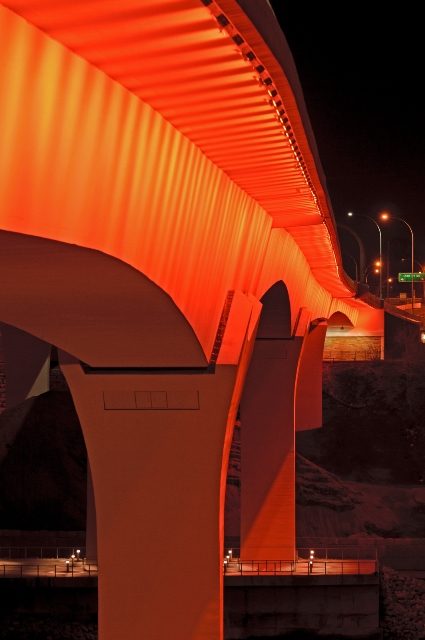 I-35W bridge lit up with orange light