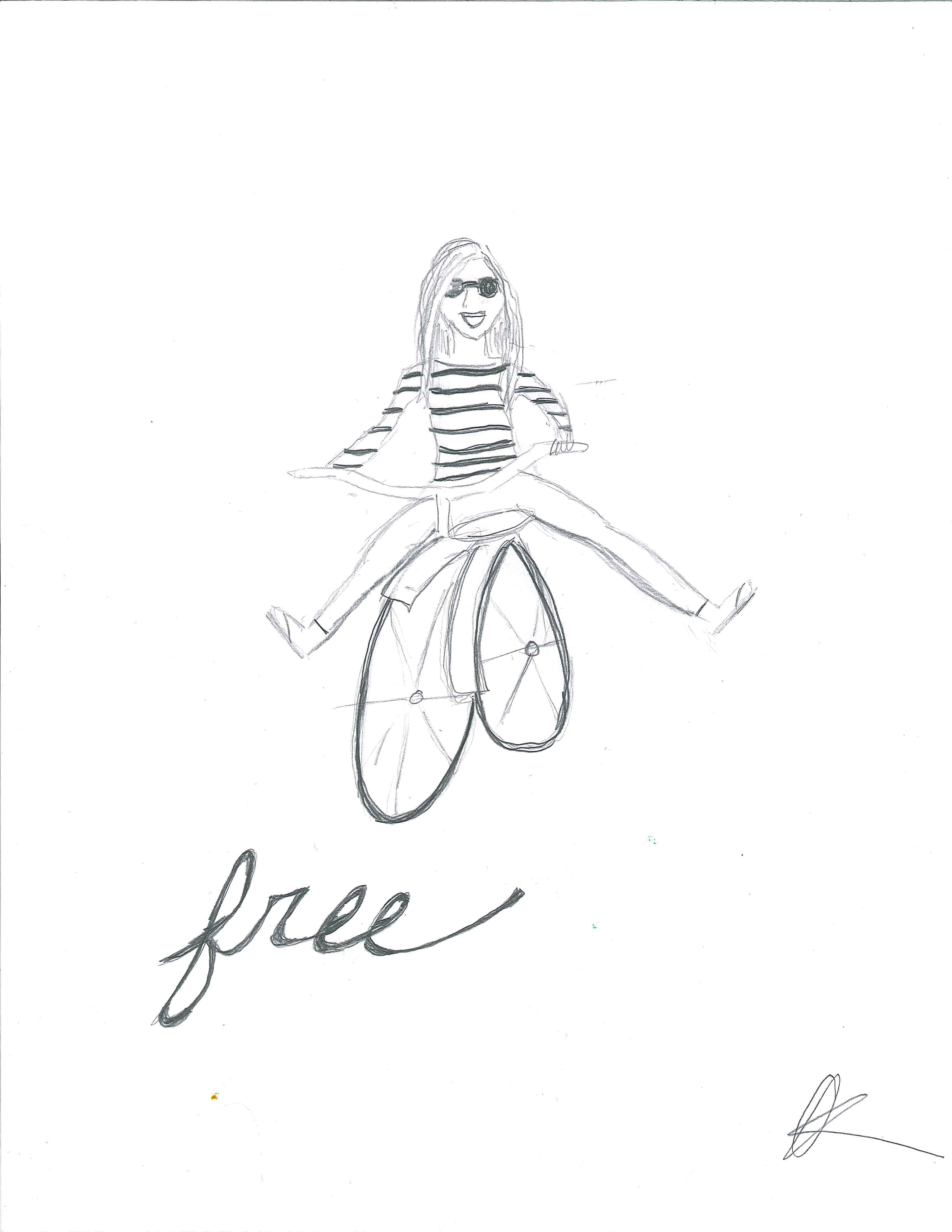 "Girl on bicycle with feet in the air. Caption is ""Free""."