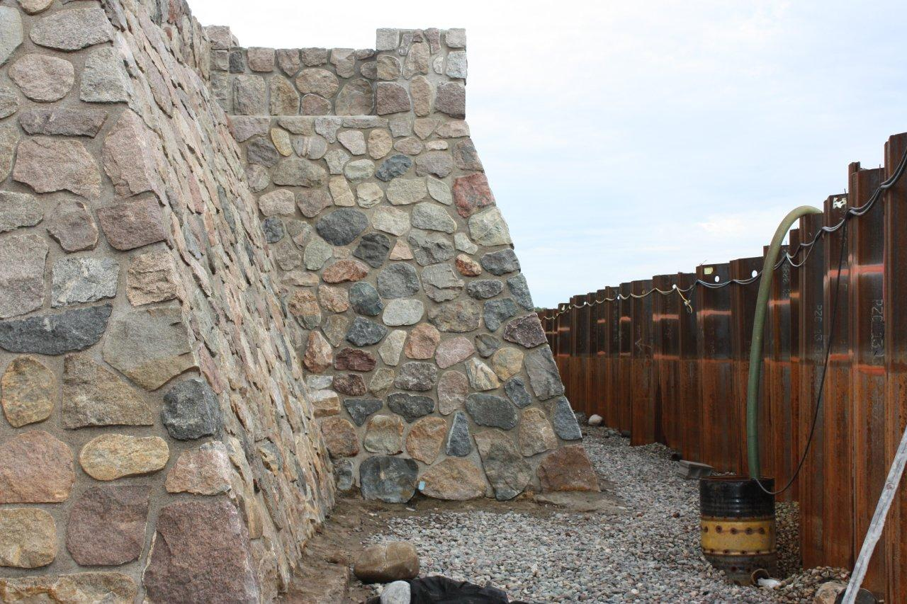 The restored concourse wall with sheet pile still holding back Lake Mille Lacs, circa 2011.