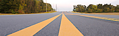 yellow striping on highway pavement