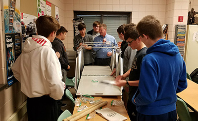 Students test bridge kit in classroom