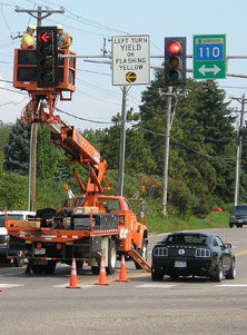 Workers installing a traffic signal.