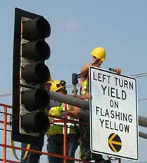 Installing a flashing yellow light signal.