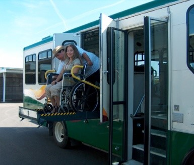 Person in wheelchair using a bus lift
