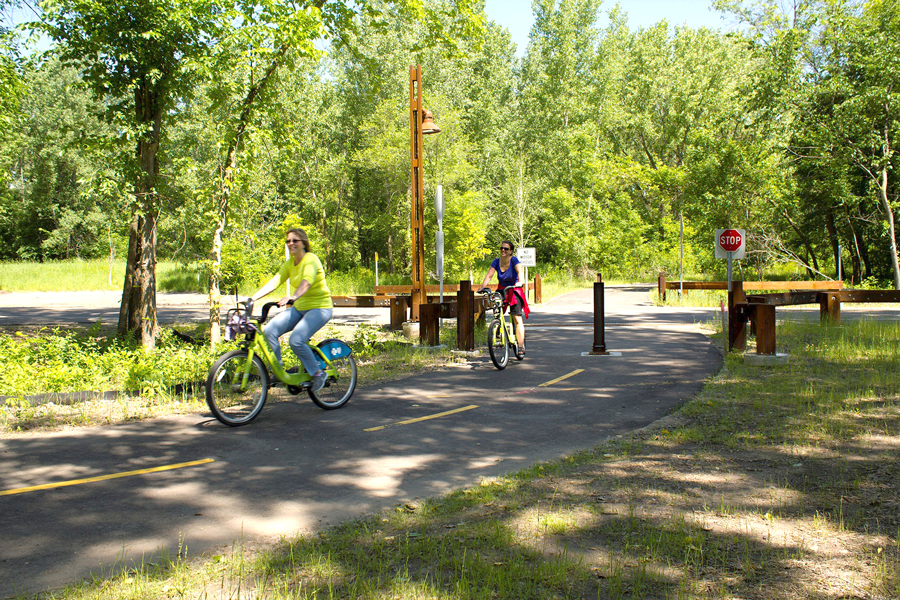 Bicyclists biking along a path