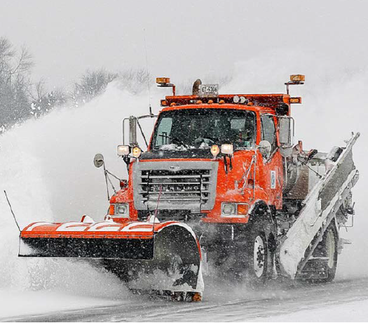 MnDOT snow plow clearning a road