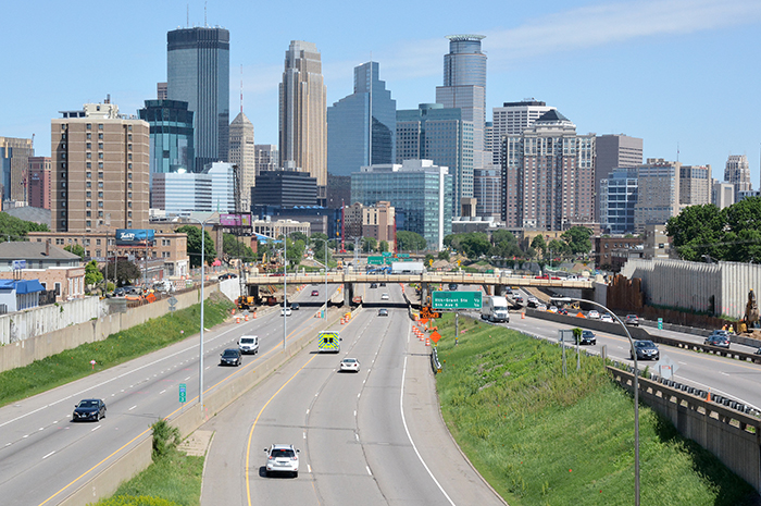 Freeway leading into Minneapolis with skyline in background