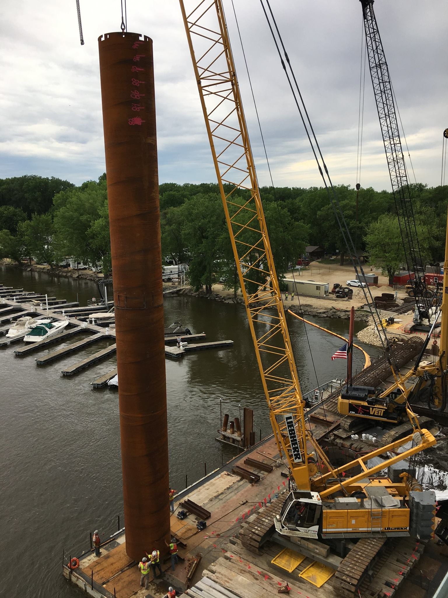 View of river bridge Pier 2 construction in the Mississippi River in June 2018. Construction crews use boats and barges to access this pier for construction.