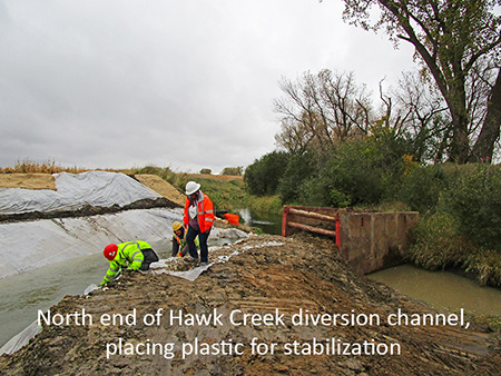North end of Hawk Creek diversion channel, placing plastic for stabilization