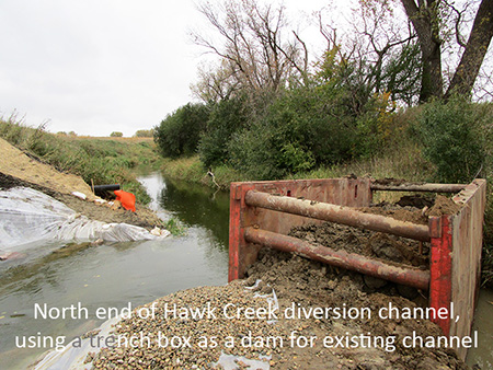 North end of Hawk Creek diversion channel, using a trench box as a dam for existing channel