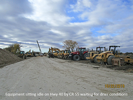 Equipment sitting idle on Hwy 40 by CR 55 waiting for drier conditions