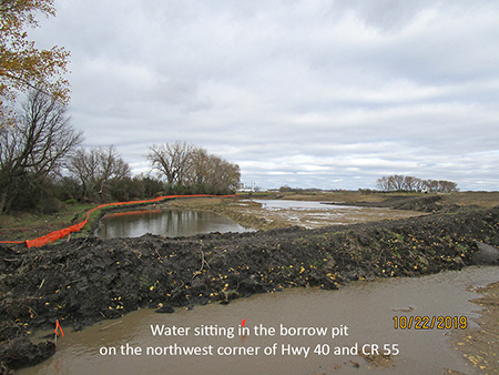 Water sitting in the borrow pit on the northwest corner of Hwy 40 and CR 55
