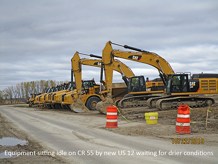 Equipment sitting idle on CR 55 by new US 12 waiting for drier conditions