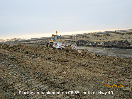 Placing embankment on County Road 55 south of Highway 40