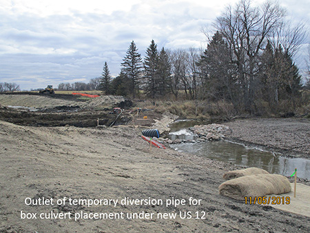 Outlet of temporary diversion pipe for box culvert placement under new US 12