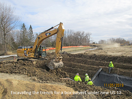 Excavating the trench for a box culvert under new US 12