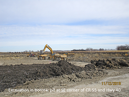 Excavation in borrow pit at SE corner of County Road 55 and Highway 40
