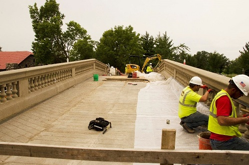 Como Pedestrian Bridge, image of working on top deck railing