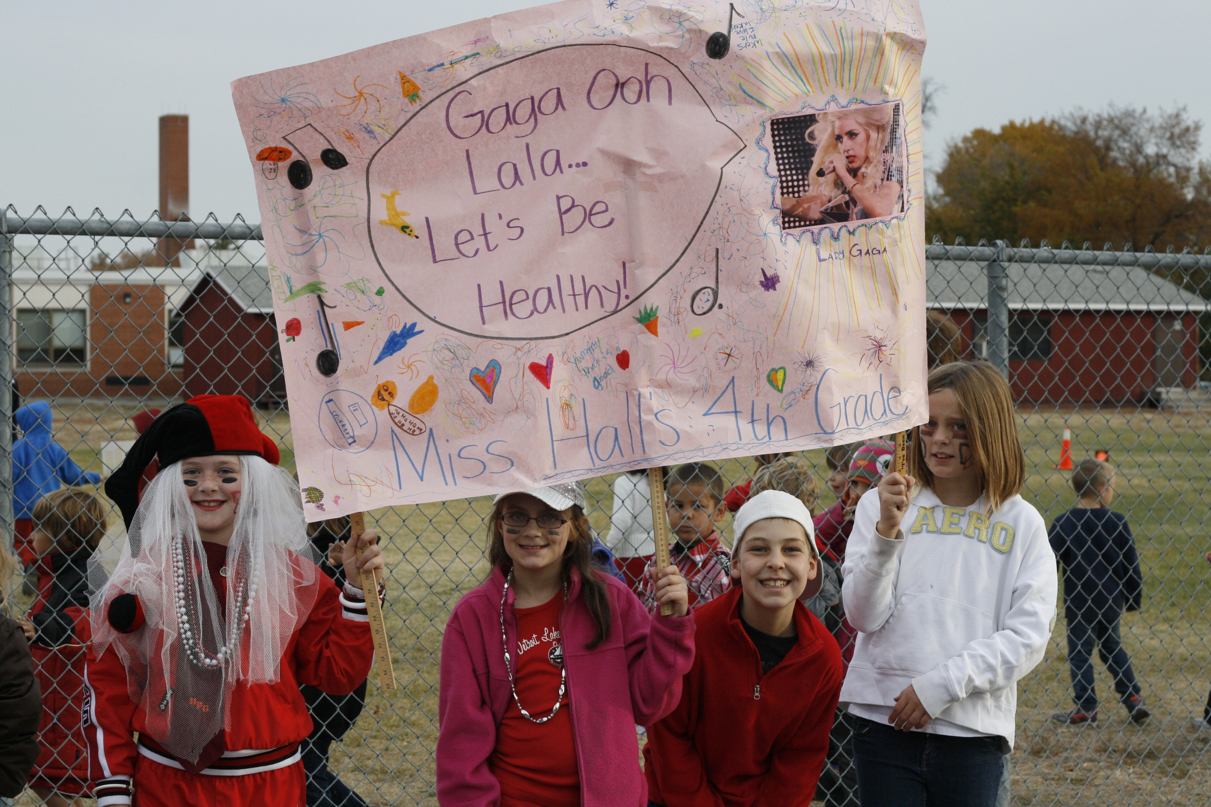Children holding homemade pro-health signs