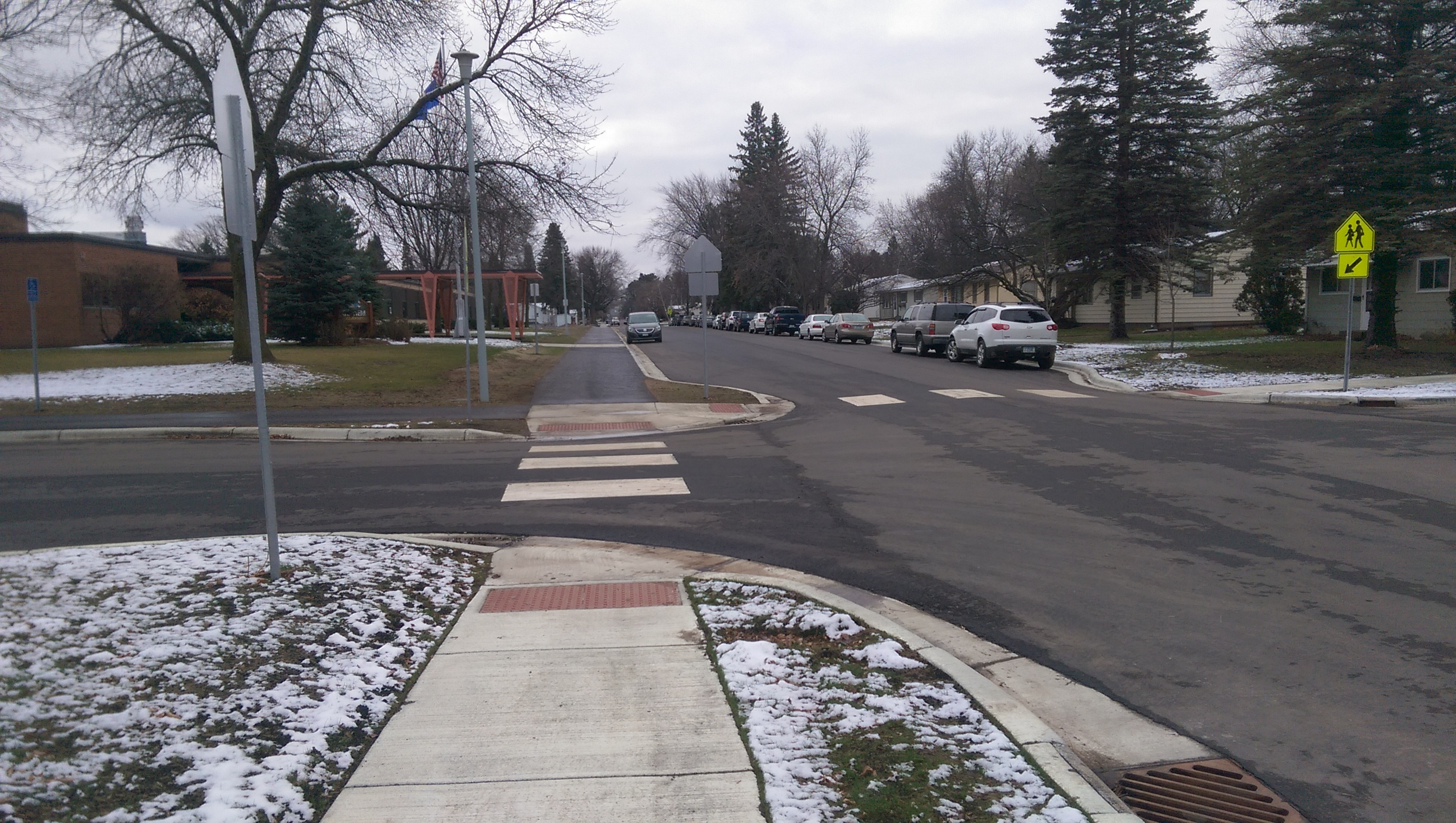 A quiet street with crosswalks near a school