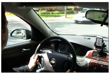 The TDSS app posts the speed limit on the screen of a dash-mounted smartphone.