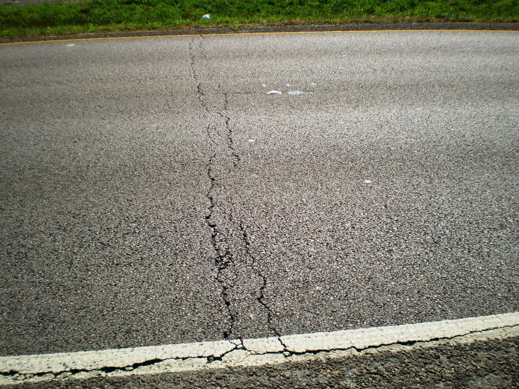 Low-temperature cracking can trigger fissures that span entire lanes of pavement, as shown here on a highway near Beaumont, Minnesota.