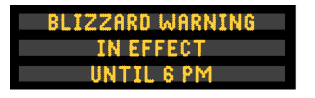 A blizzard warning appears in yellow text on a Dynamic Message Sign.