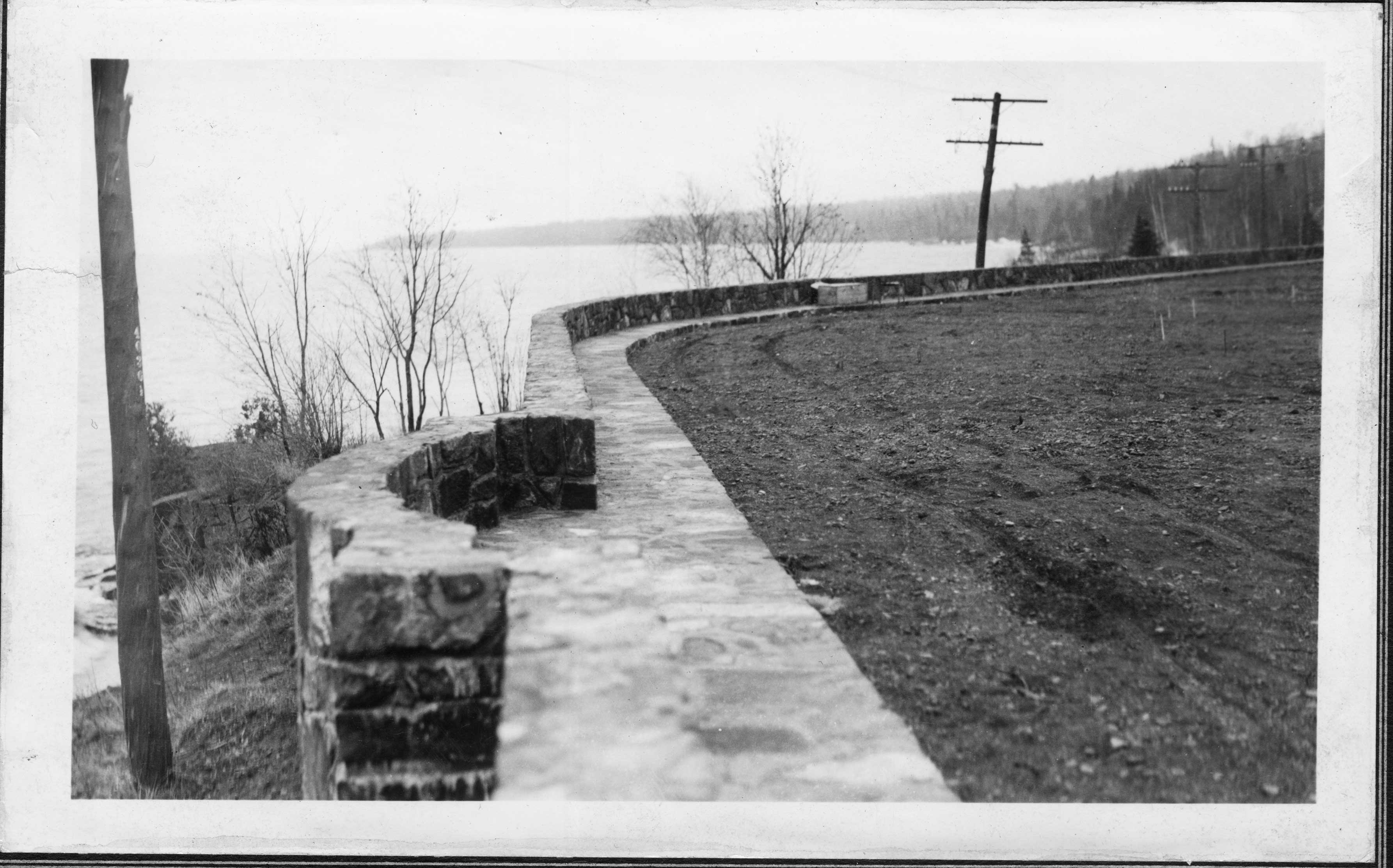 The flagstone walk and wall overlook, looking south. Notice the drive is not yet paved.